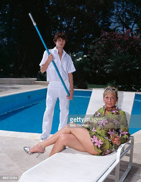Mature woman and pool attendant