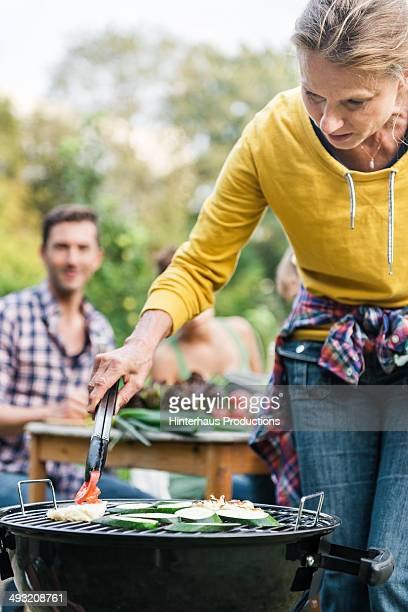Mature Woman At Barbeque Grill