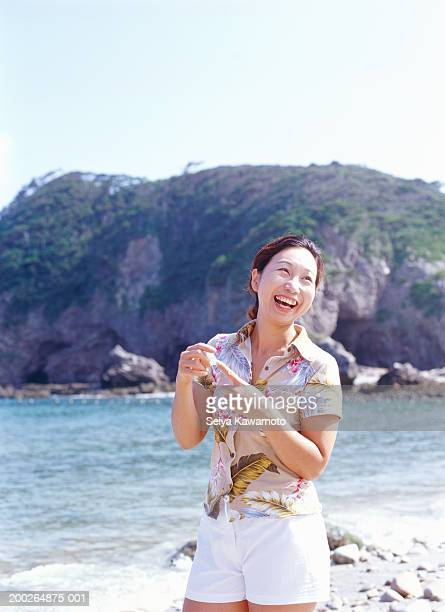 Mature woman at beach, laughing