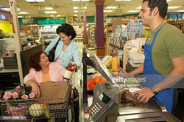 Mature woman at the cash counter of a supermarket