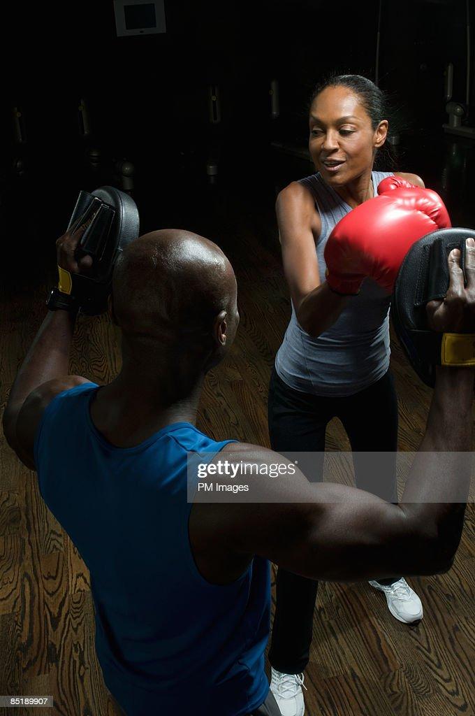 Mature woman boxing : Stock Photo