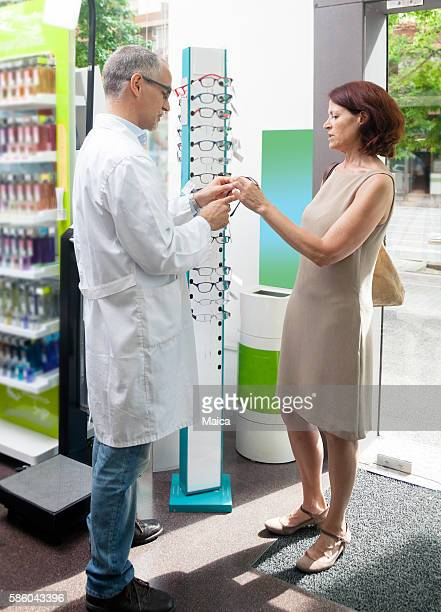 Mature woman buying glasses