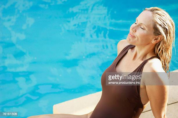 Mature woman by swimming pool (high angle view)