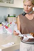 Mature woman checking shopping receipts