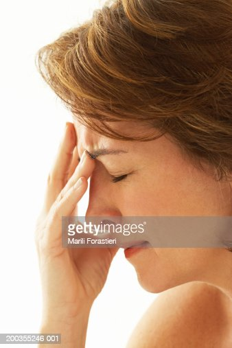 Mature woman crying, side view, close-up : Stock Photo