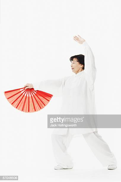 Mature woman dancing while holding a parasol