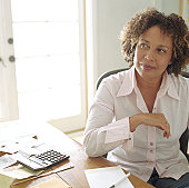 Mature woman doing finances in  home office, portrait