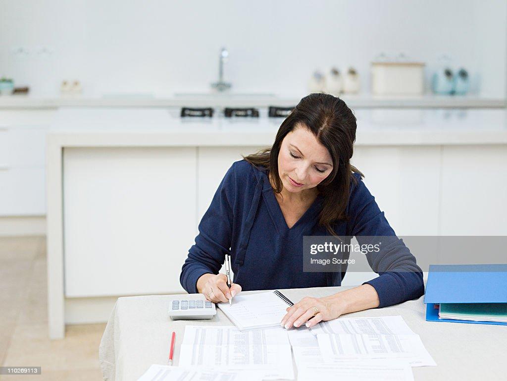 Mature woman doing home finances