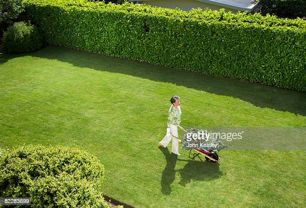 Mature woman doing yard work