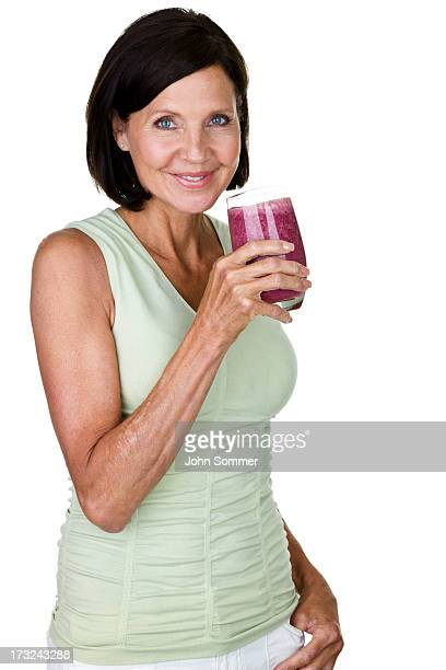 Mature woman drinking a fruit smoothie