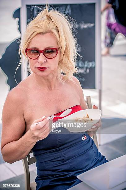 Mature Woman Eating Ice Cream
