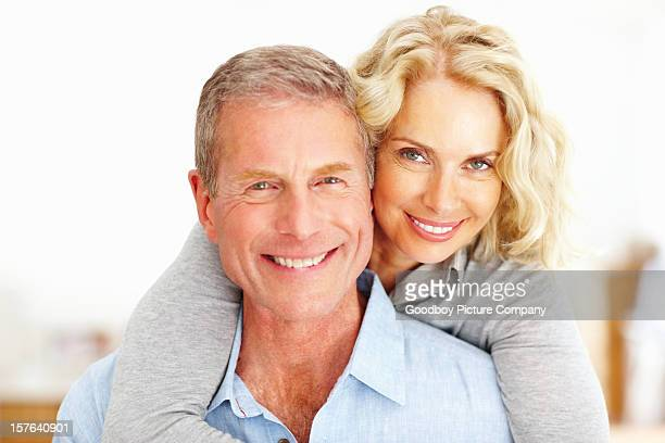 Mature woman embracing man from behind