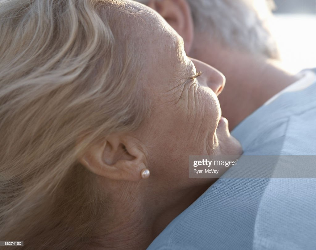 Mature woman embracing man : Stock Photo