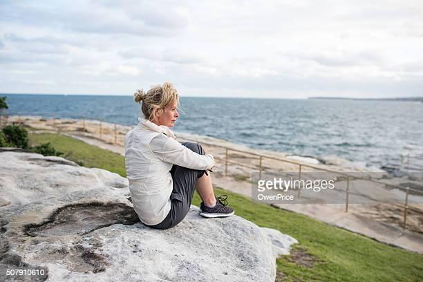 Mature woman enjoying the ocean view Sydney Australia