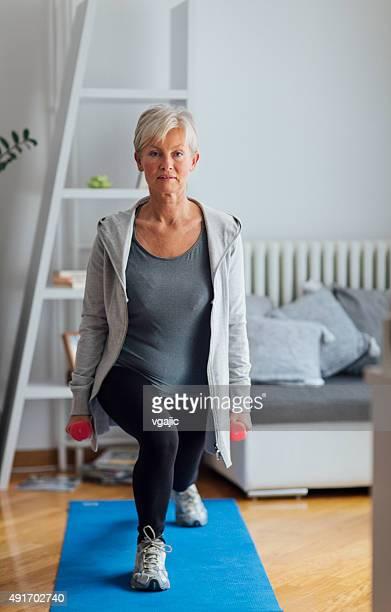 Mature Woman Exercising At Home.