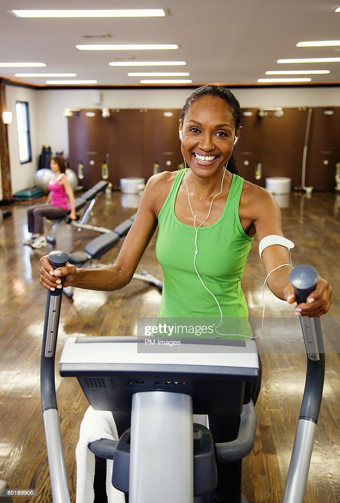 Mature woman exercising : Stock Photo