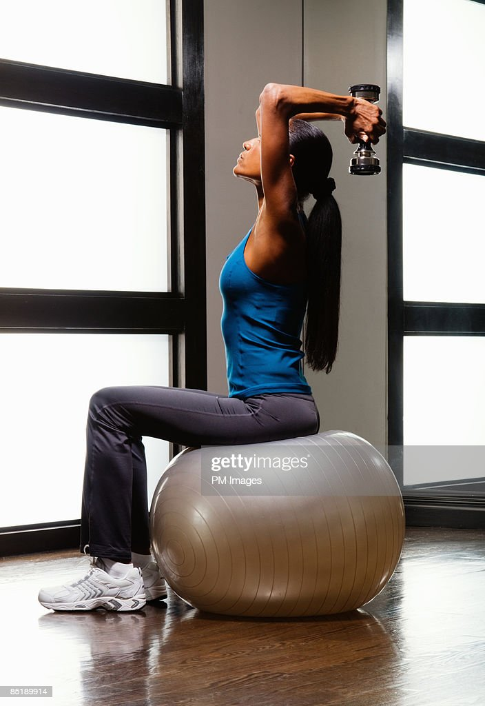 Mature woman exercising : Stock Photo