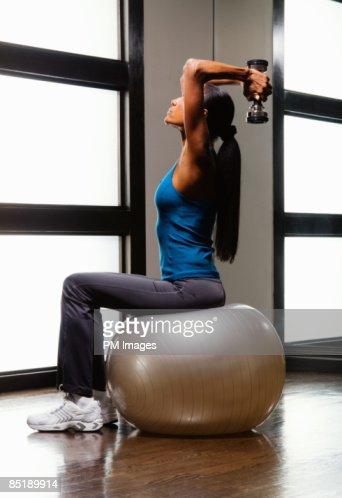 Mature woman exercising : Stockfoto