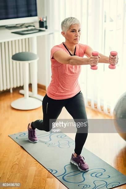 Mature Woman Exercising Pilates.