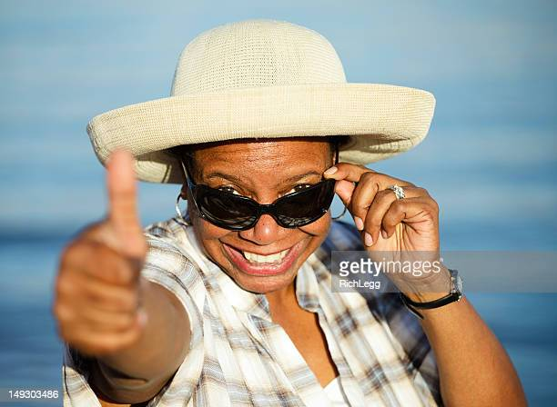 Mature Woman Giving a Thumbs Up