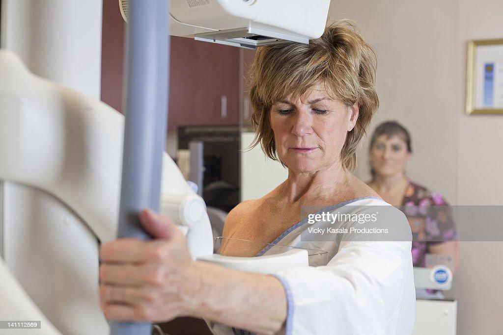 Mature woman having a mammogram.