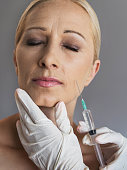 Mature woman having anti aging treatment with Botox.
