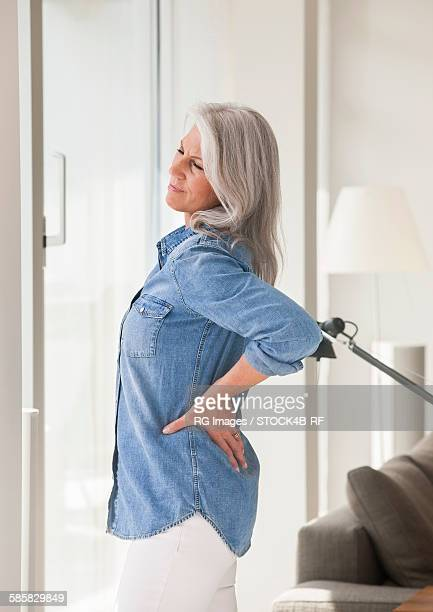 Mature woman having back pain