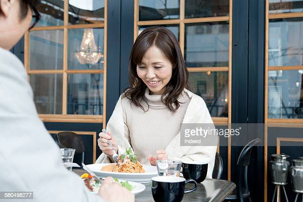 Mature woman having lunch at restaurant