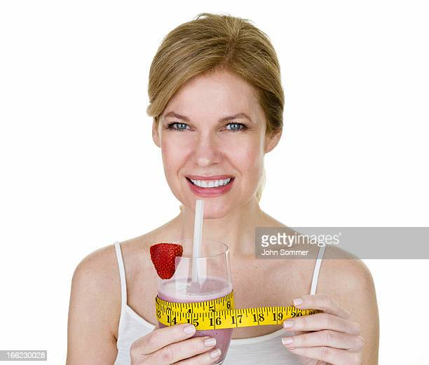 Mature woman holding a smoothie