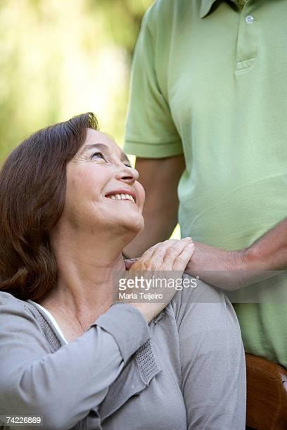 Mature woman holding man's hand
