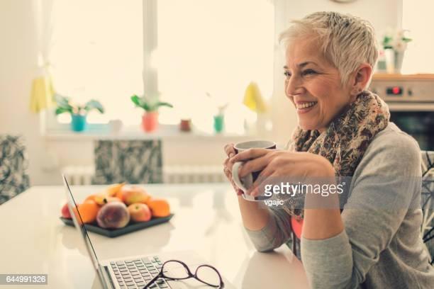 Mature woman Home budgeting