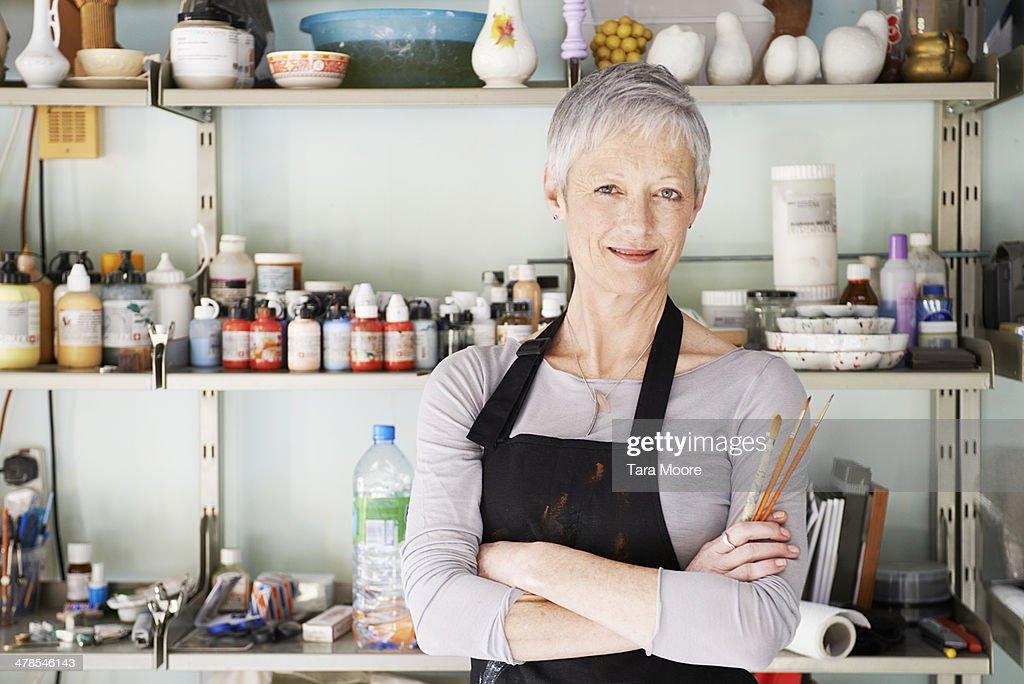 mature woman in artist's studio