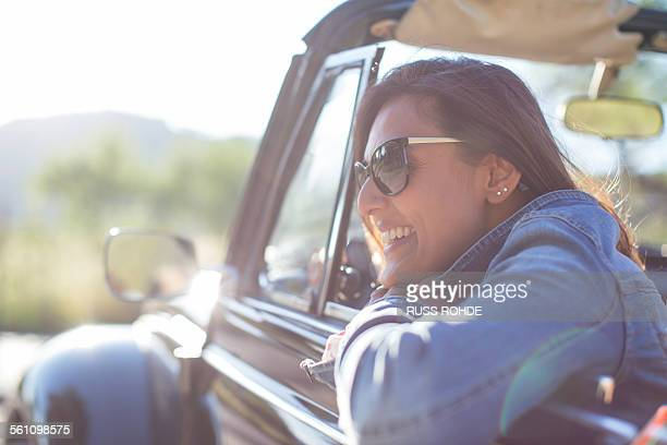Mature woman in convertible car