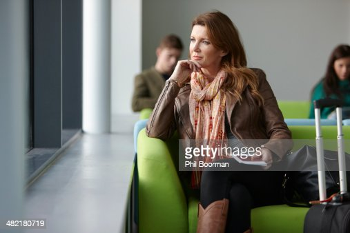 Mature woman in departure lounge