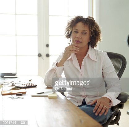 Mature woman in  home office, portrait