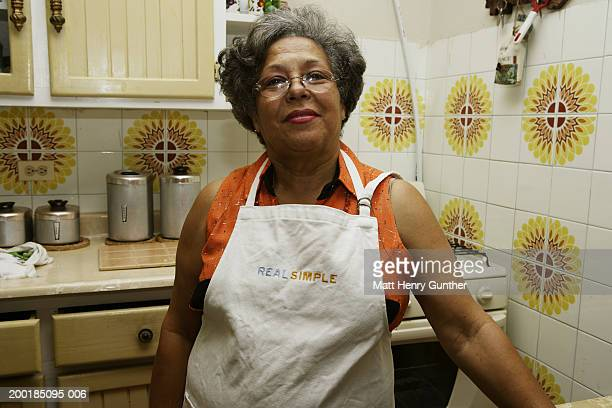 Mature woman in kitchen, portrait