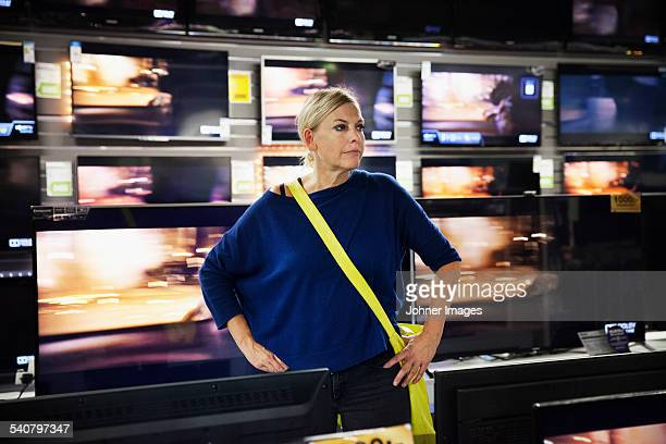 Mature woman in TV shop