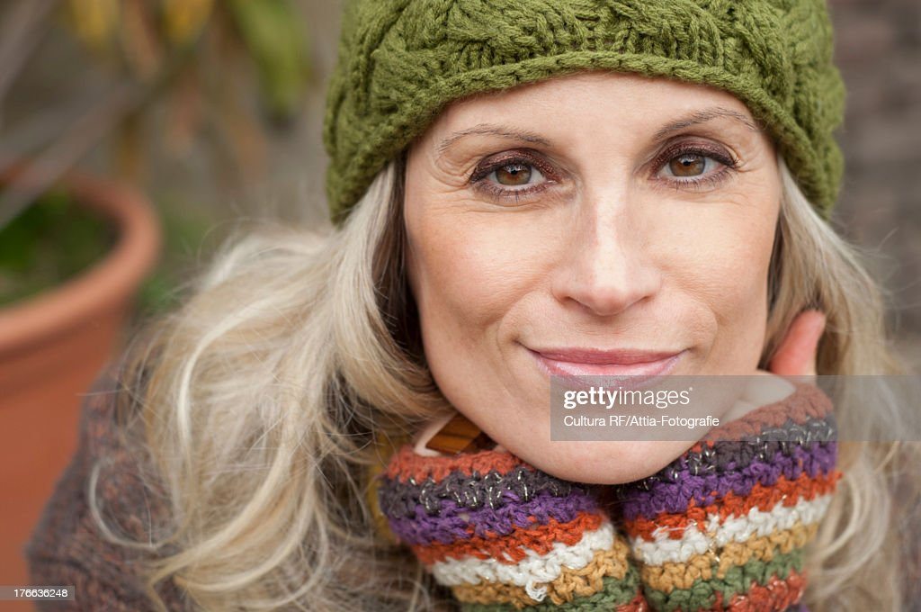 Mature woman in warm clothing and knit hat, portrait : Stock Photo