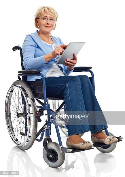 Mature woman in wheelchair with digital tablet