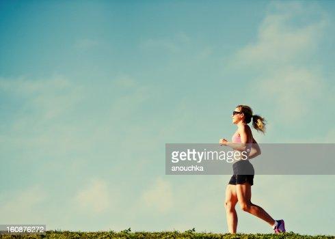 Mature Woman Jogging Outdoors : Stock Photo