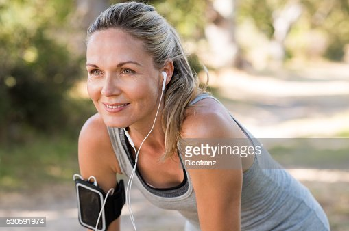 Mature woman jogging : Stock Photo