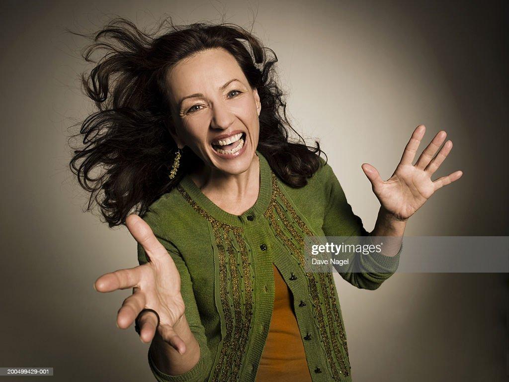 Mature woman laughing, portrait : Stock Photo
