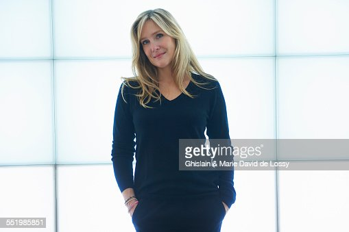 Mature woman leaning against backlit wall panels