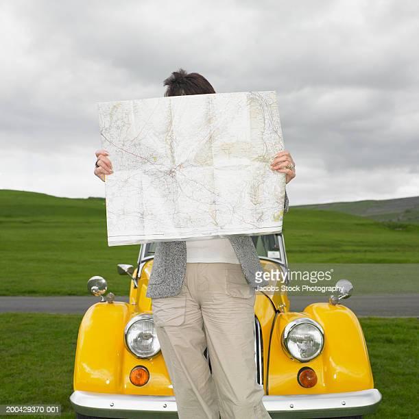 Mature woman looking at map