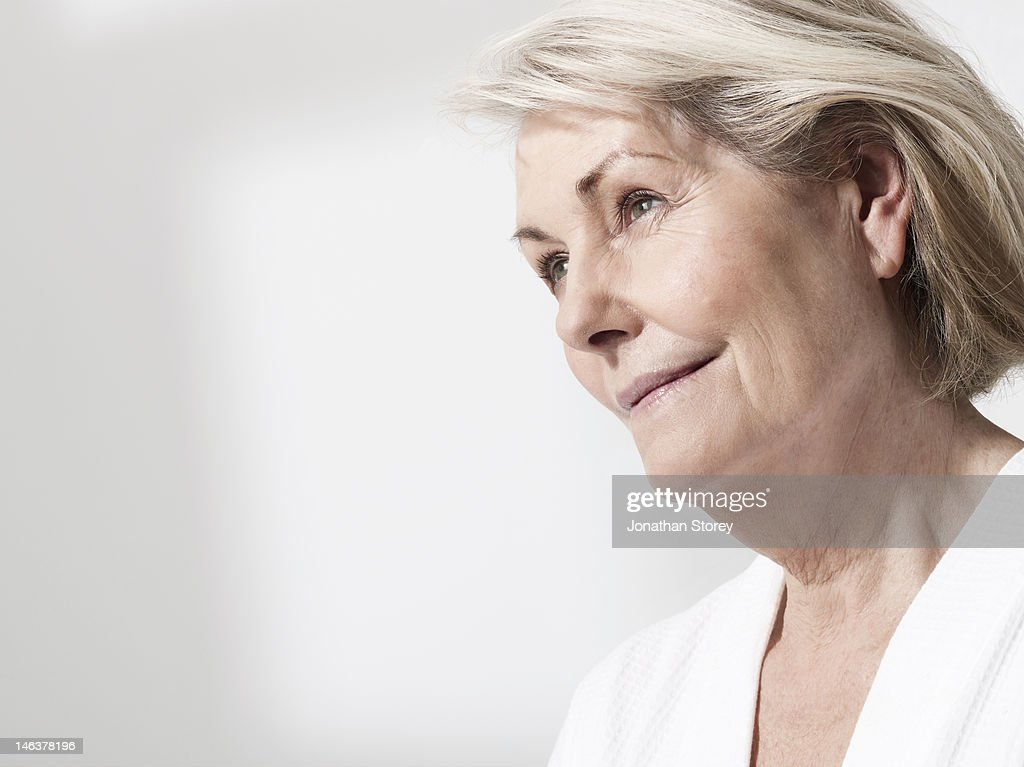 Mature woman looking in to the distance : Stock Photo