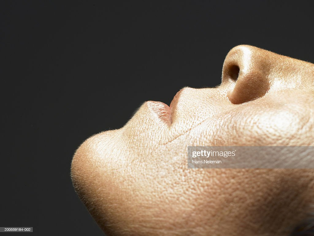 Mature woman looking up, close-up : Stock Photo