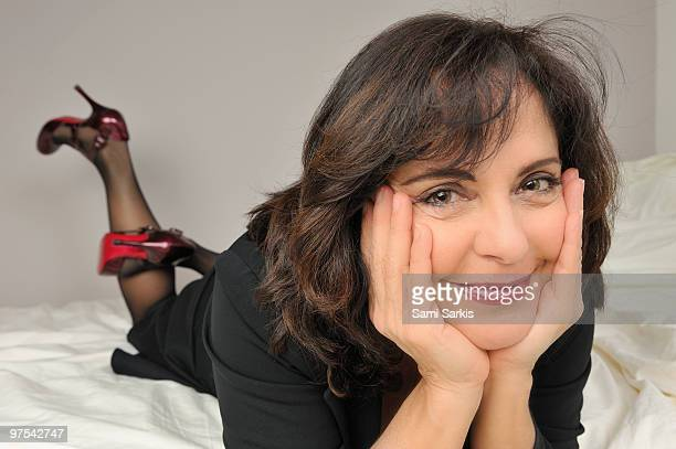 Mature woman lying on bed with high heels - Mature Women In High Heels Stock Photos And Pictures Getty Images