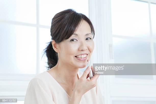 A mature woman making up