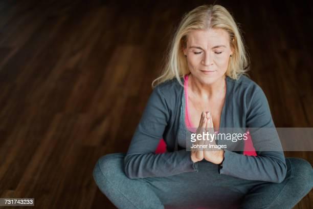 Mature woman meditating