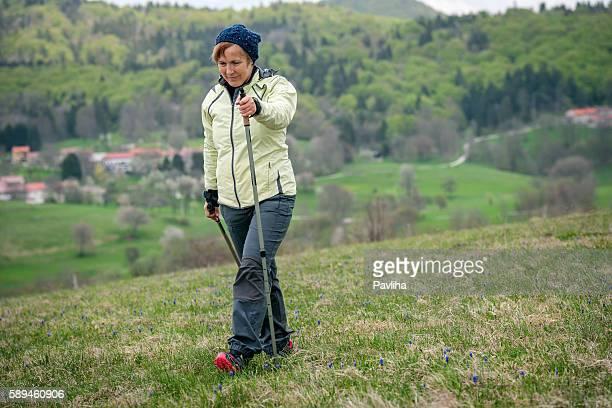 Mature Woman Nordic Walking on Plateau, Slovenia, Europe